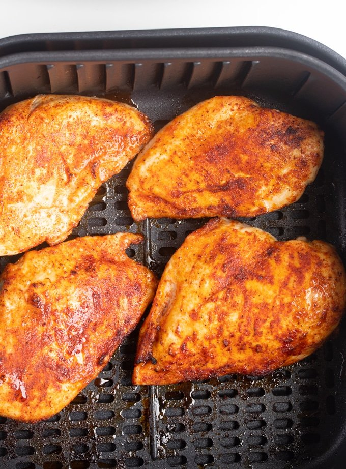 cooked chicken breast in an air fryer basket
