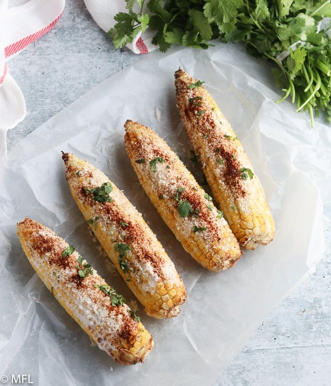 air fried mexican street corn on a blue background