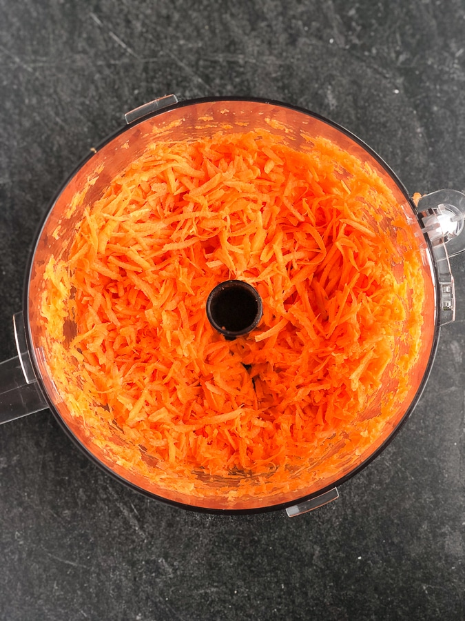 grated carrots in food processor bowl