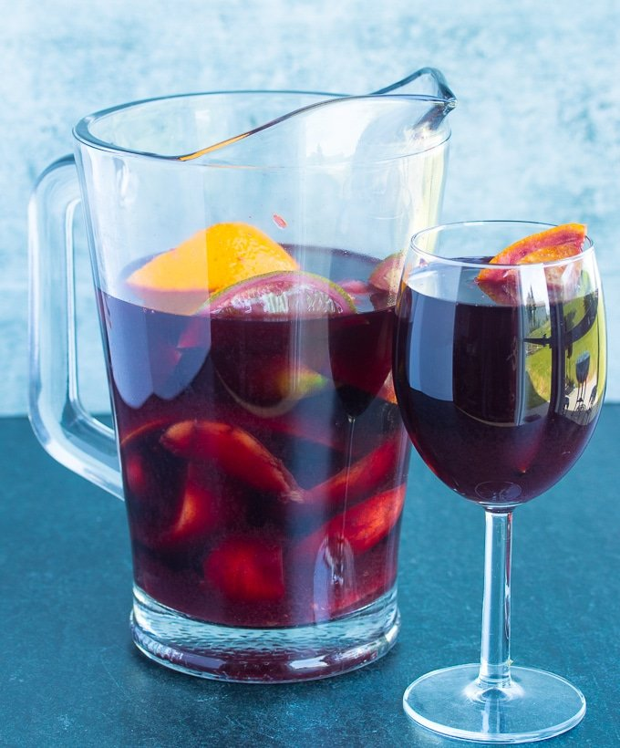 glass of red wine and pitcher