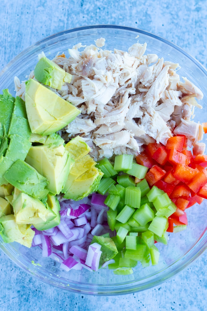 rotisserie chicken salad ingredients laid out in a bowl