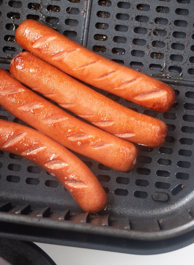 air fryer hot dogs cooked in air fryer basket