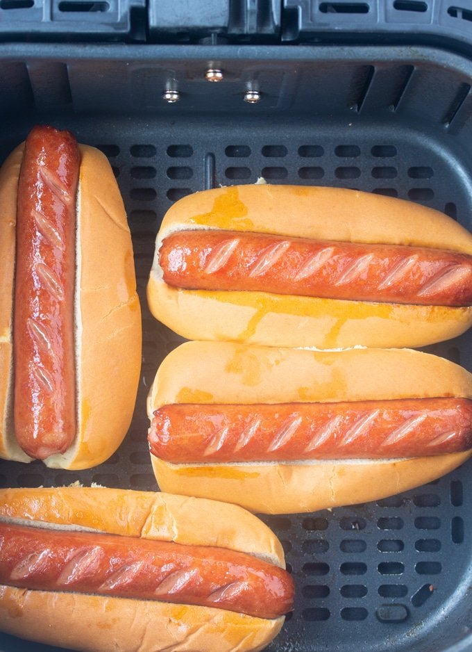 air fryer hot dogs in an air fryer basket