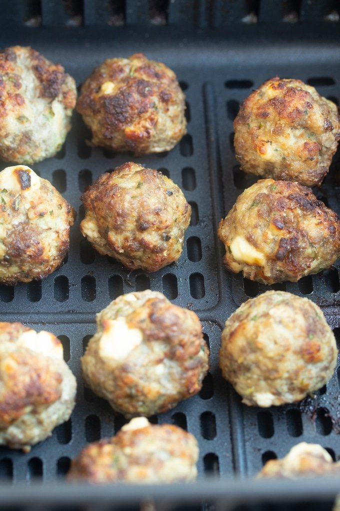 cooked air fryer meatballs in the air fryer basket