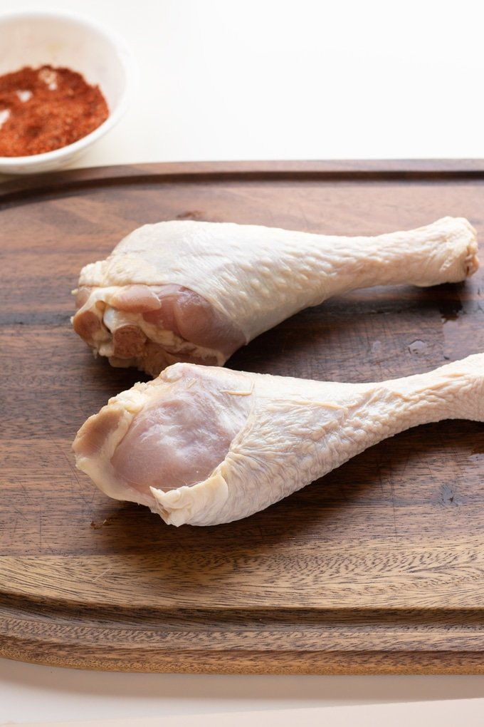 raw turkey legs on cutting board