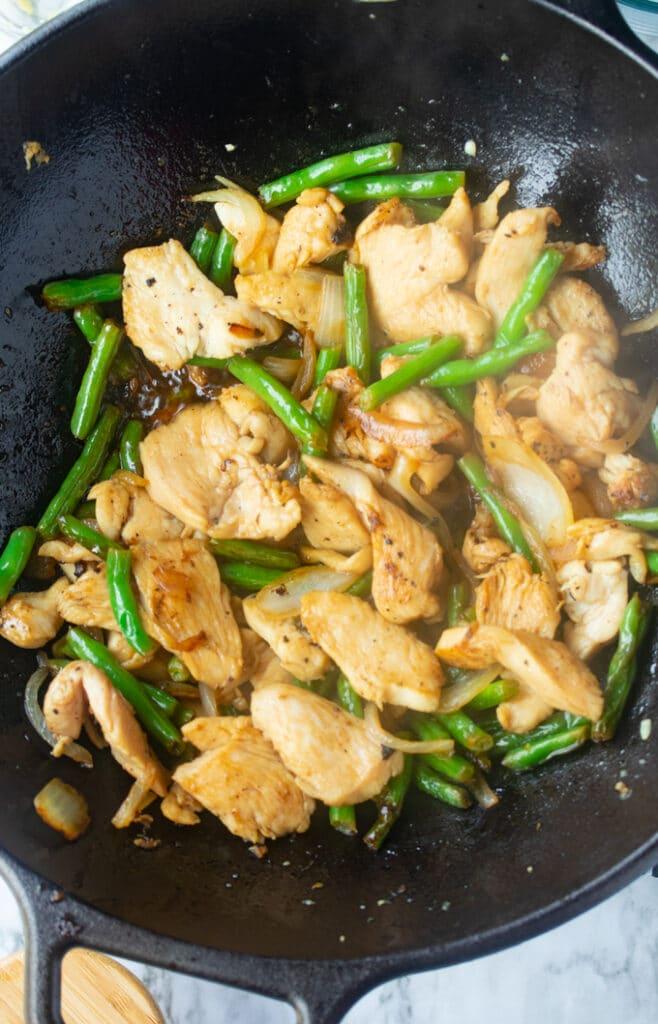 chicken and green bean stir fry in wok