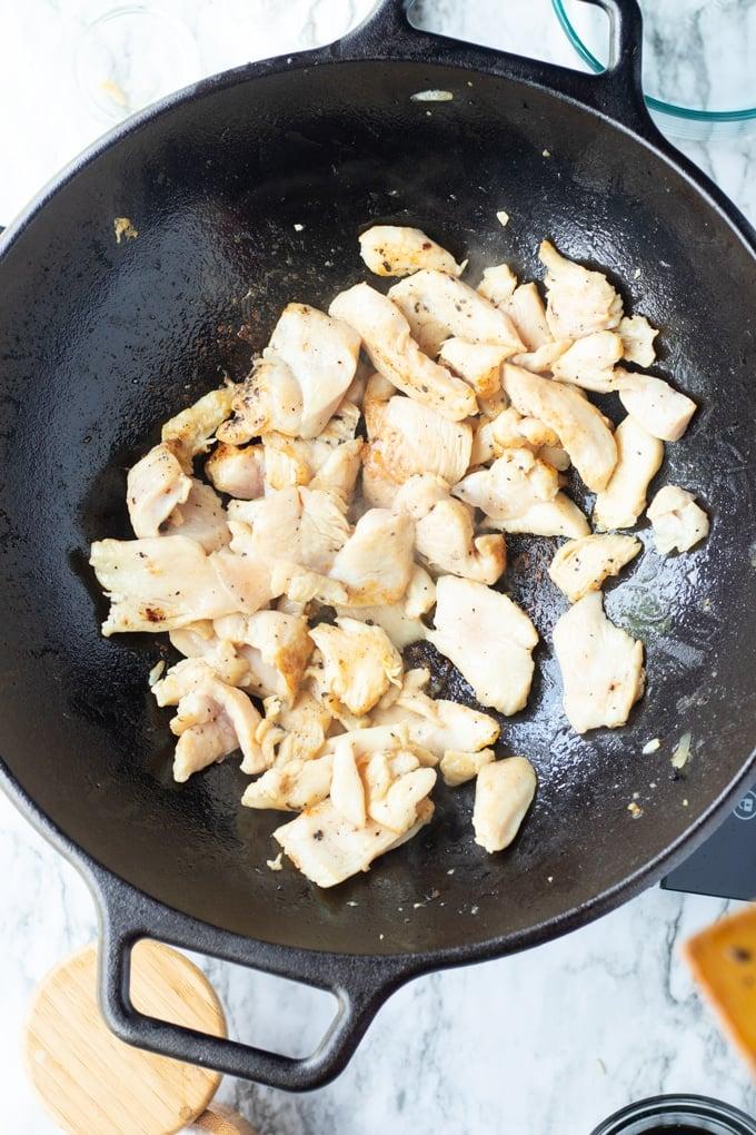 chicken pieces in a wok
