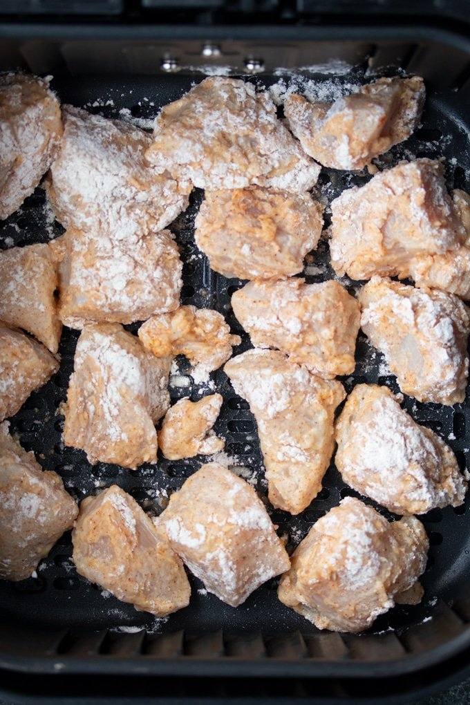 air fryer chicken pieces in air fryer basket before cooking