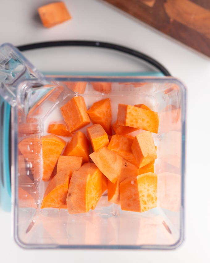 sweet potato chunks in bender with coconut milk on bottom