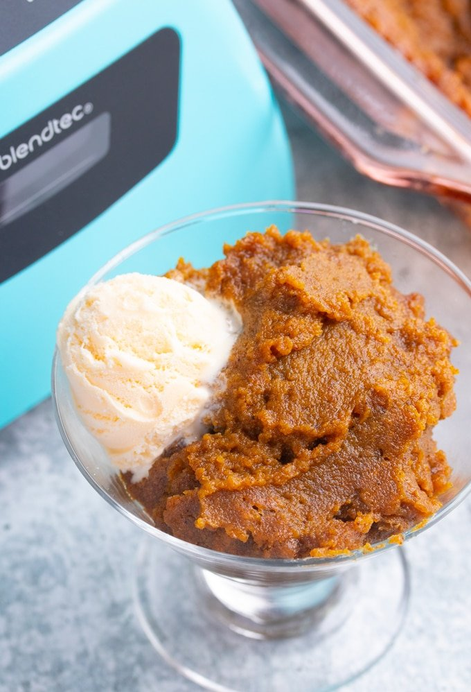 sweet potato pudding in glass jar with a scoop of ice cream in front of blender