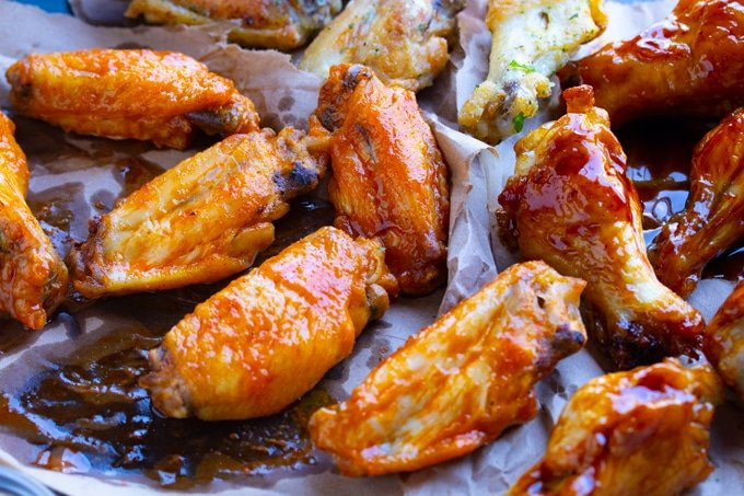 chicken wings in sauce on paper