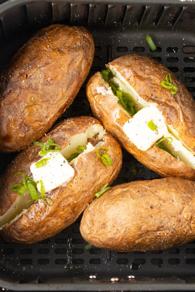 air fryer baked potatoes in air fryer basket
