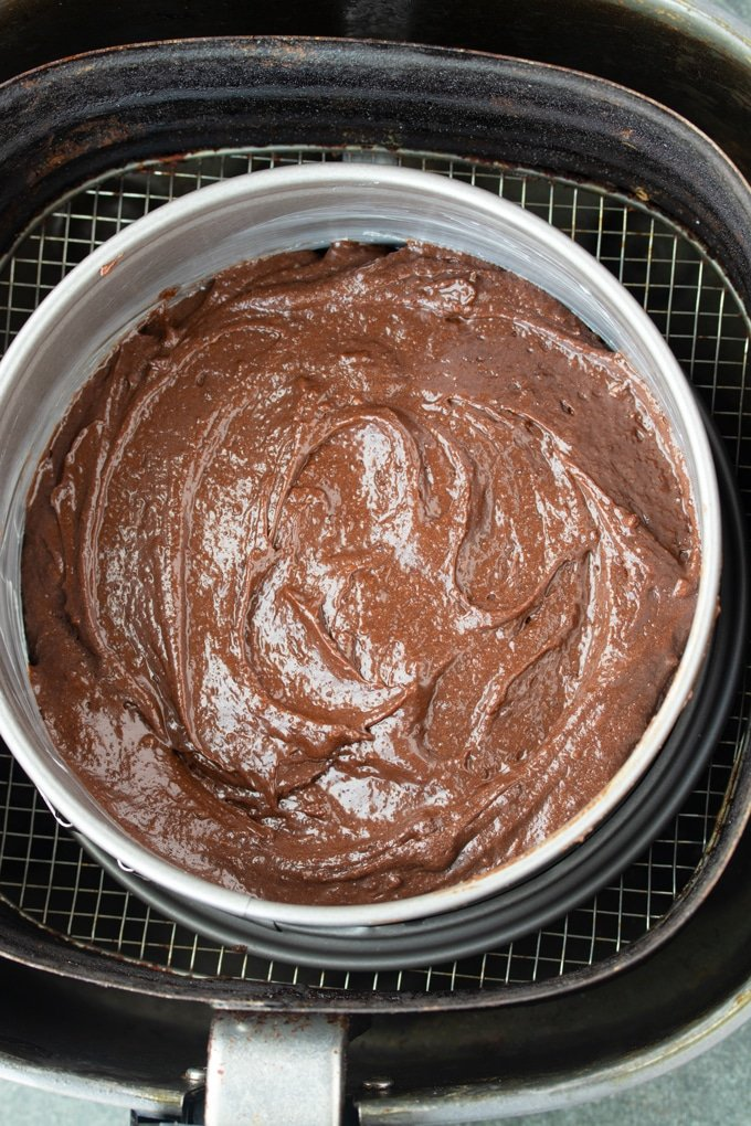 brownie batter in baking pan in air fryer basket