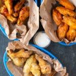 chicken wings in blue baskets