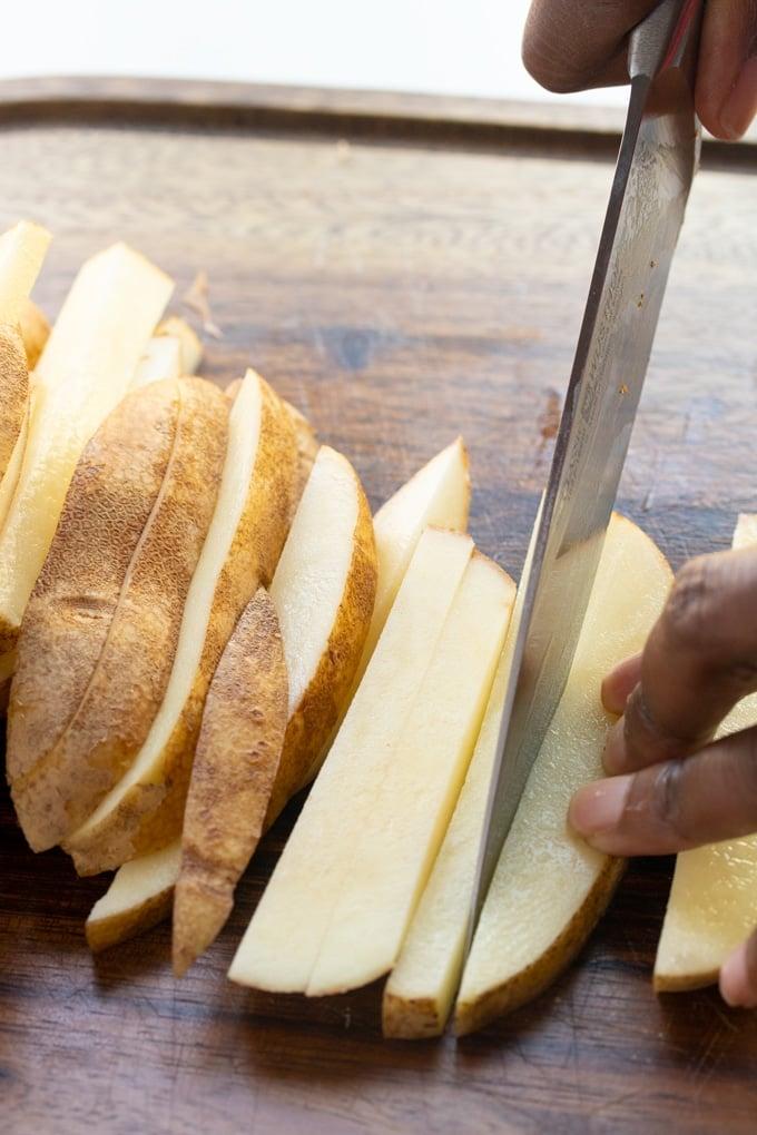 knife cutting potato