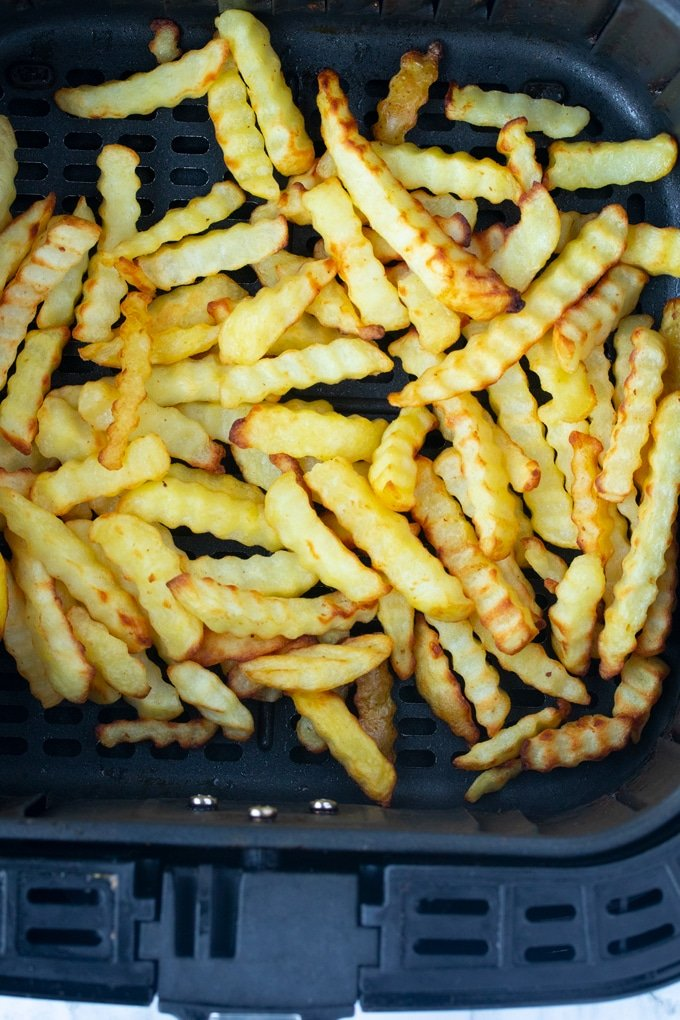 cooked french fries in basket