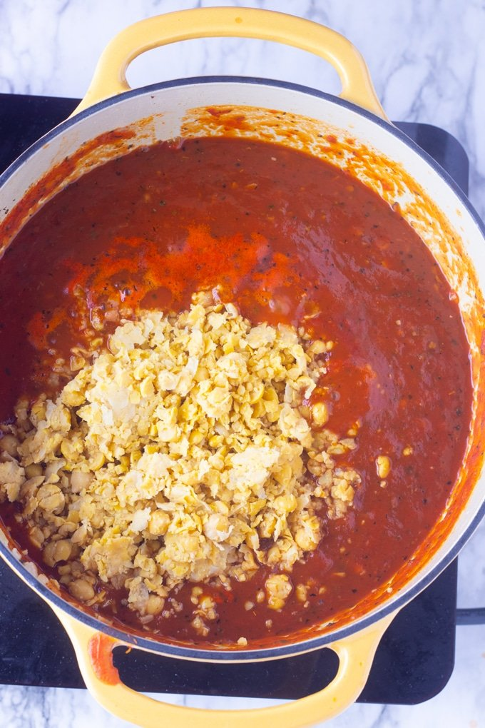 vegetarian spaghetti sauce with chickpeas on top of it
