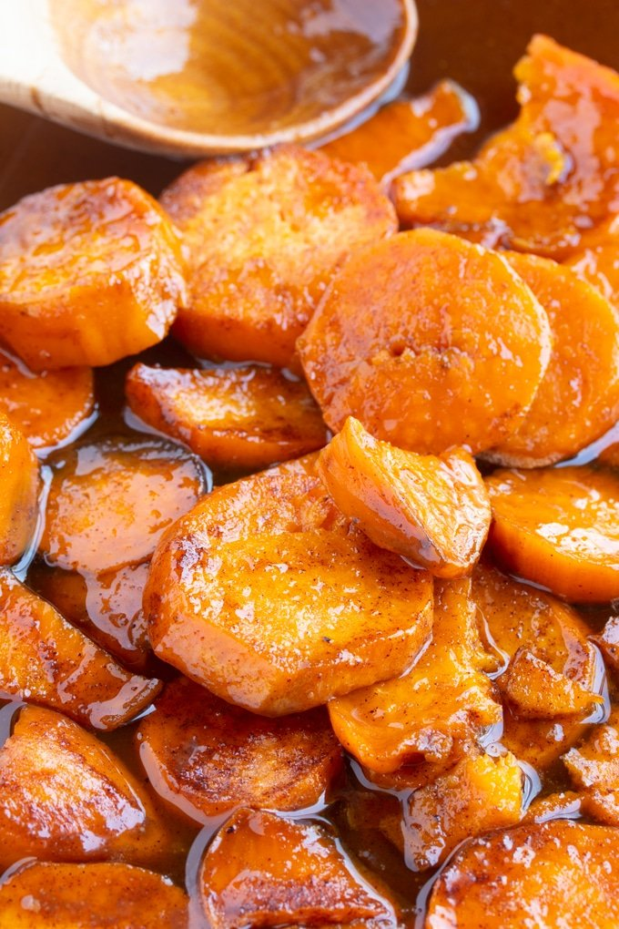 southern candied sweet potatoes up close with spoon in background