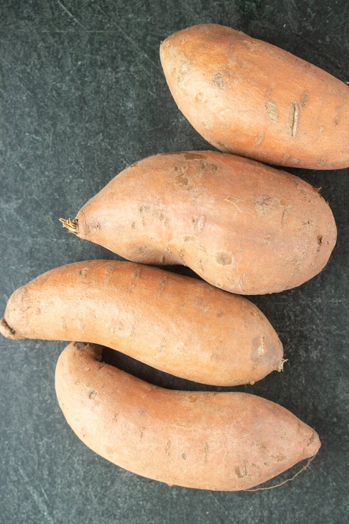 four whole ray sweet potatoes