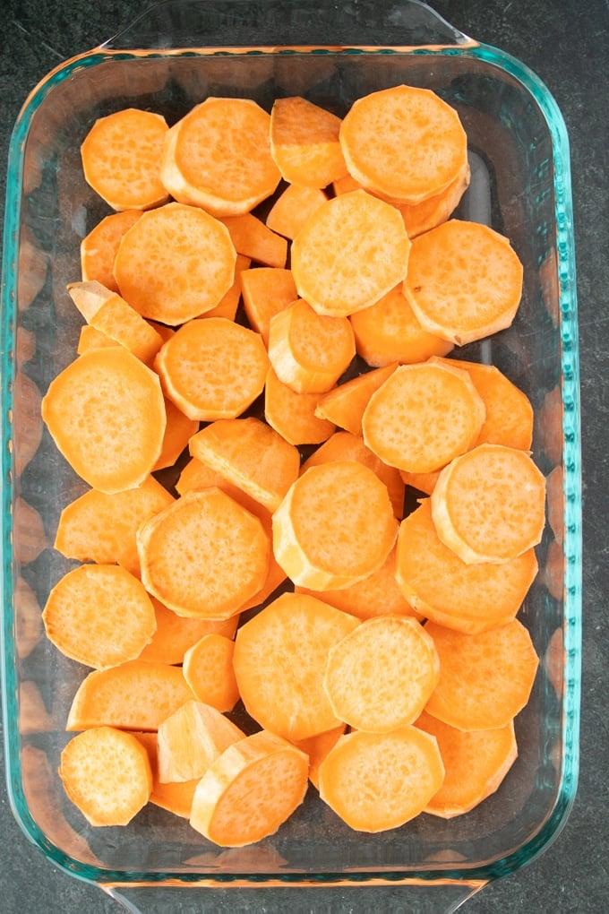 sliced sweet potatoes in 13x9 pan