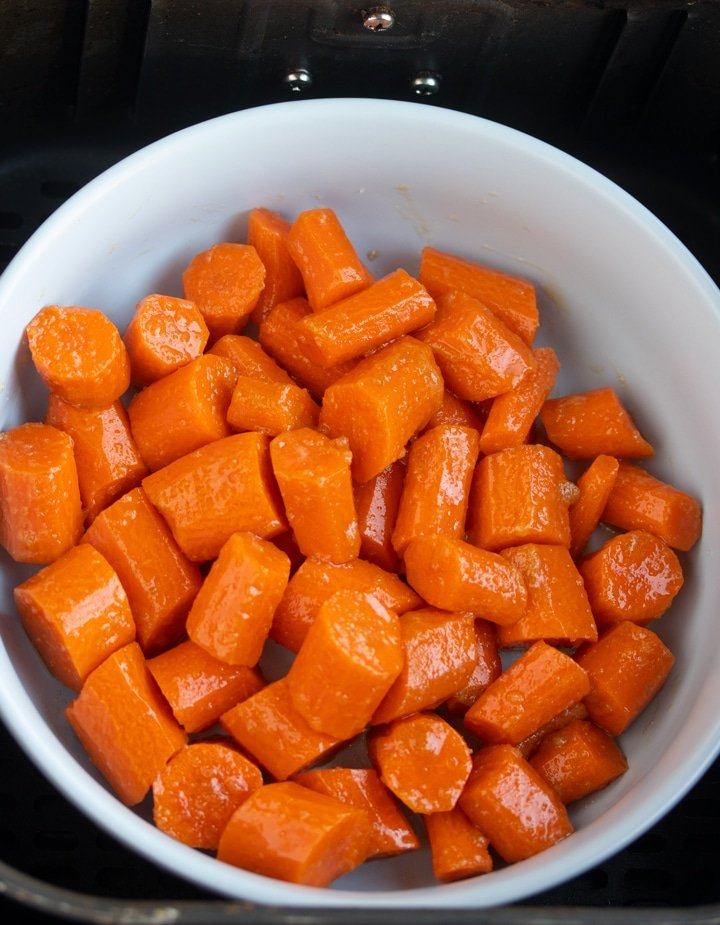 chopped carrots in bowl in air fryer basket