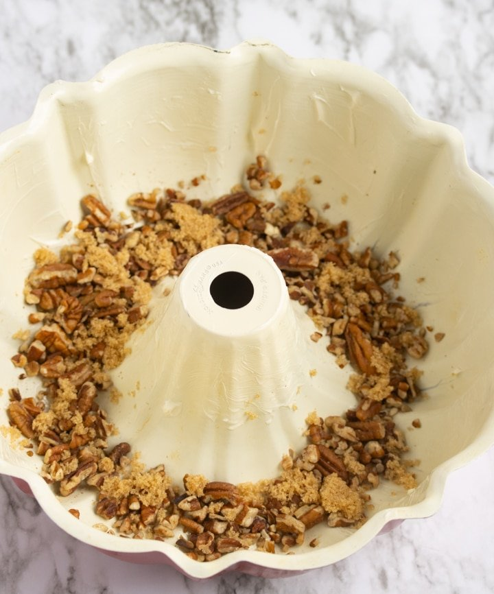 pecans and brown sugar in bottom of bundt pan