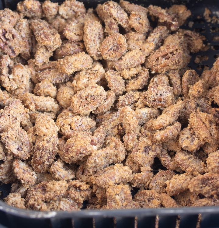 finished sugared pecans in air fryer basket
