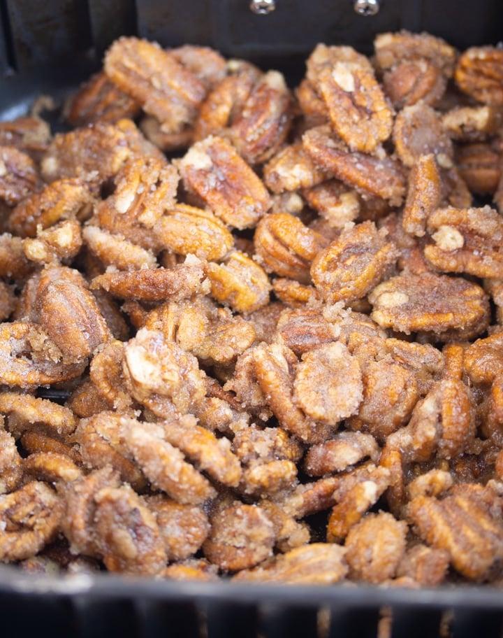 pecans covered in sugar in air fryer basket
