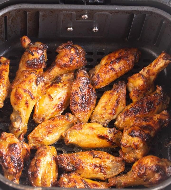 charred wings in air fryer basket
