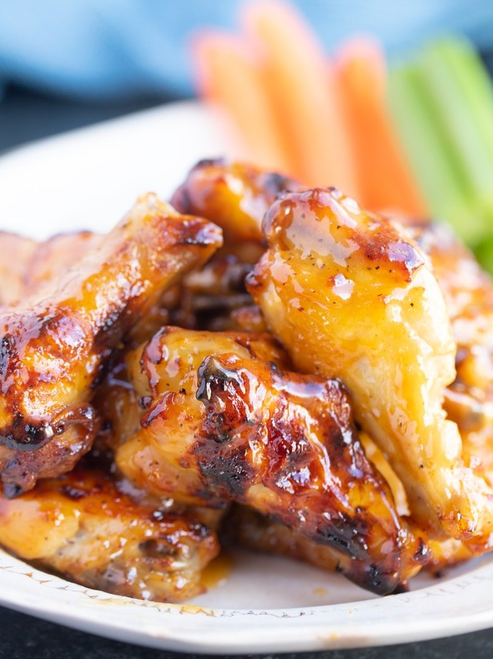 honey mustard wings on a plate, close up photo