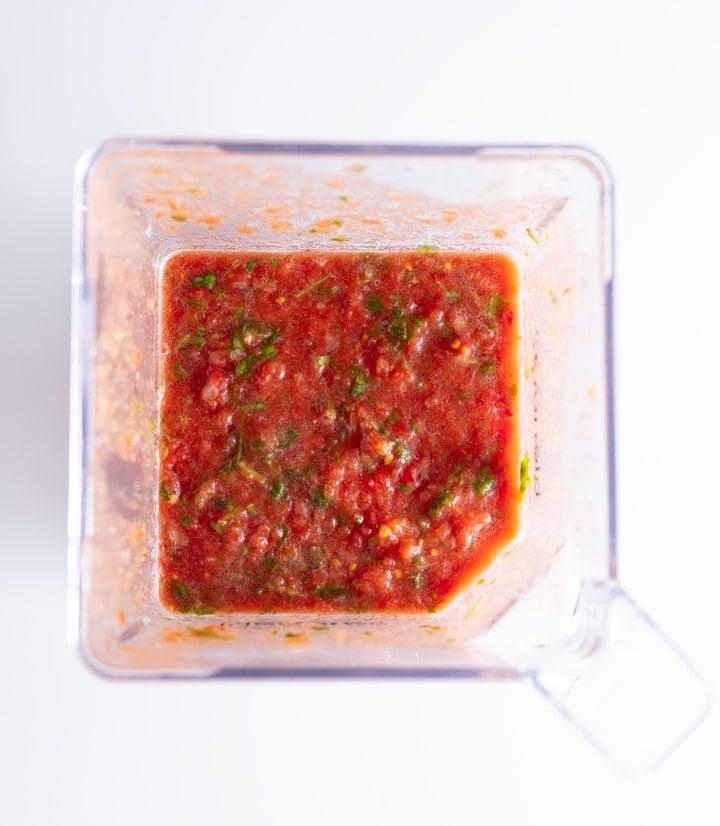 blended salsa ingredients in blender container