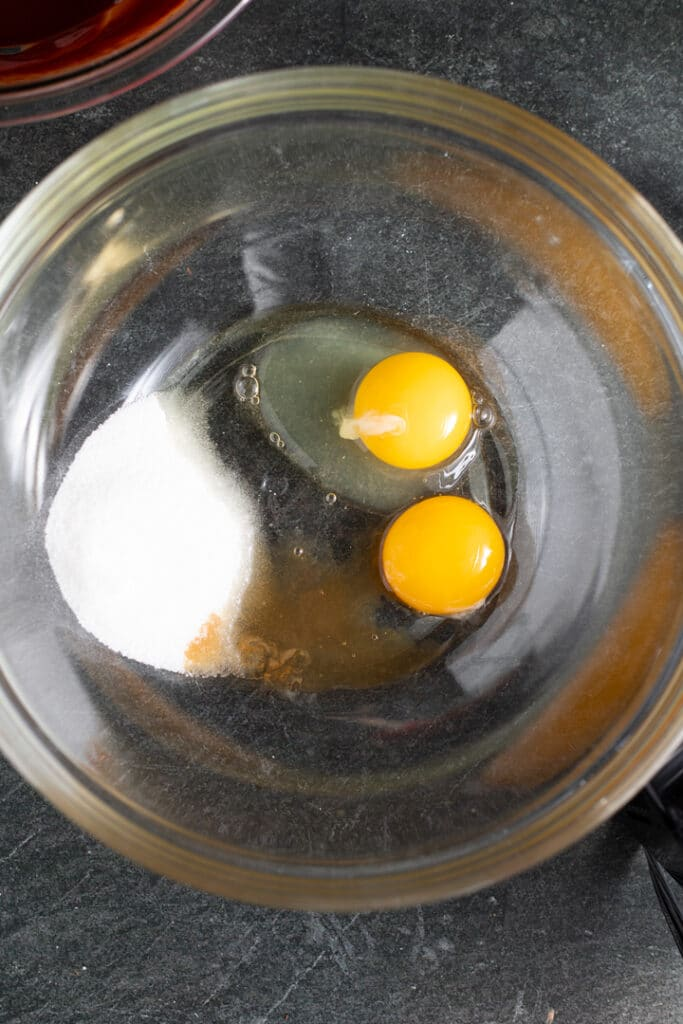eggs and sugar in glass bowl