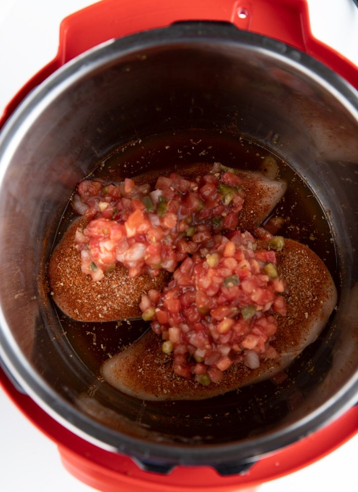 chicken in instant pot with salsa on top