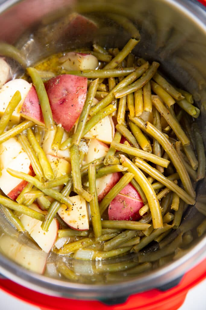 The cooked green beans and potatoes in the Instant Pot