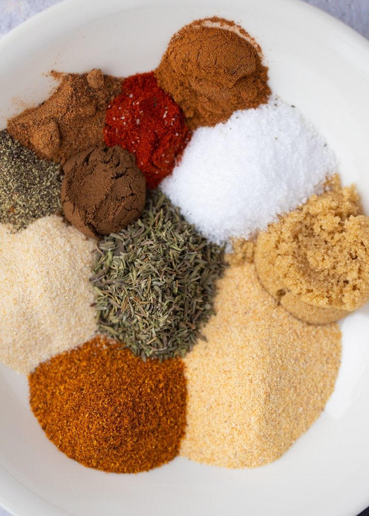 spices and herbs on white plate
