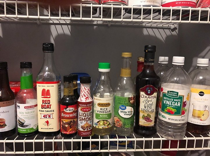 bottlles of vinegars and sauces in pantry