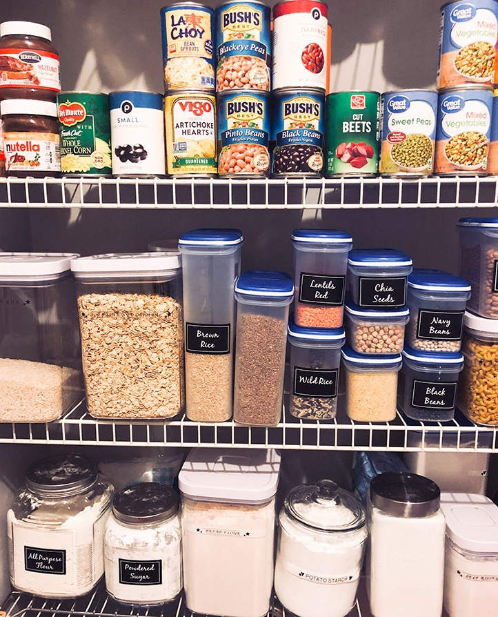 canned goods and other ingredients on shelves in a pantry