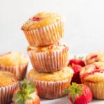 Three strawberry muffins stacked on top of each other