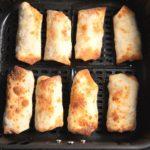 Egg rolls in an air fryer basket