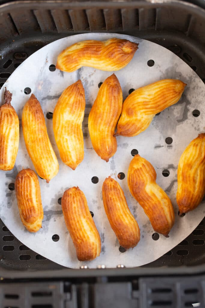 cooked churros in air fryer basket