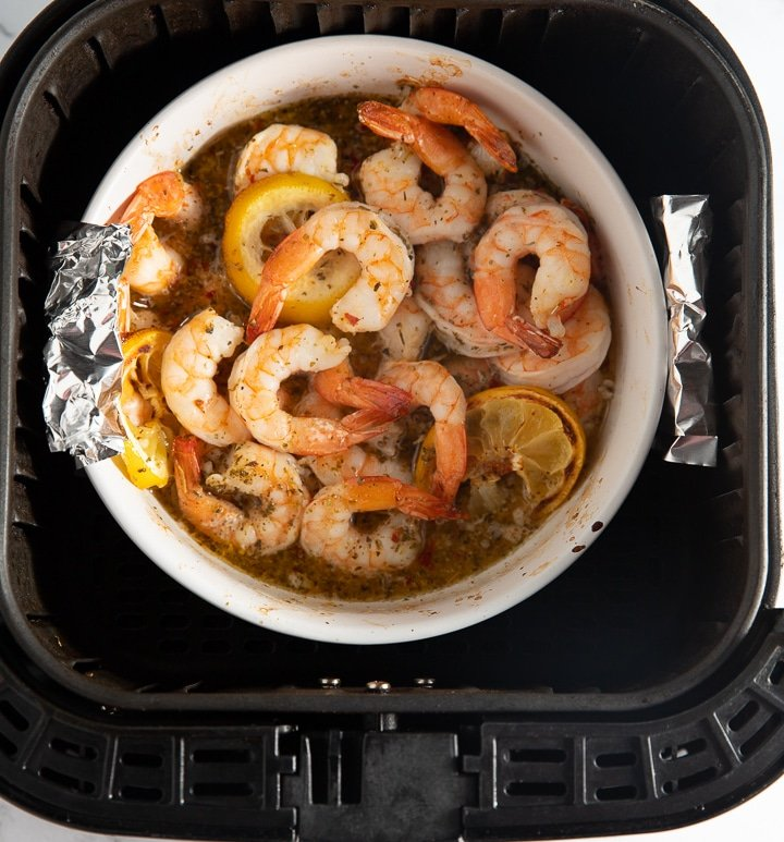 Air fryer lemon shrimp in the basket ready to serve