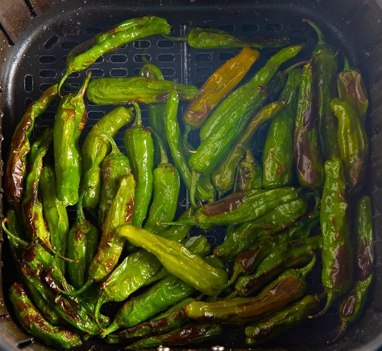 The roasted peppers in the air fryer basket