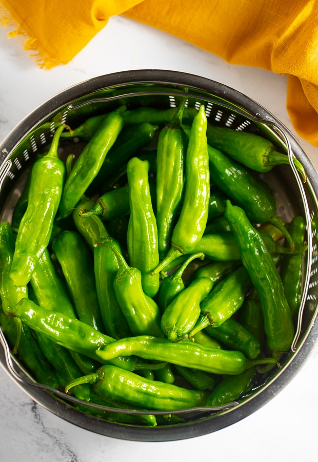 Raw peppers in a colander