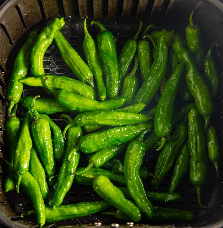 Raw peppers in the air fryer basket