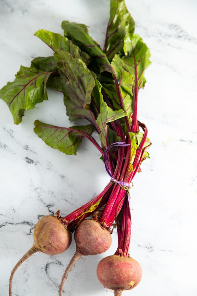 Fresh beets on a marble worktop