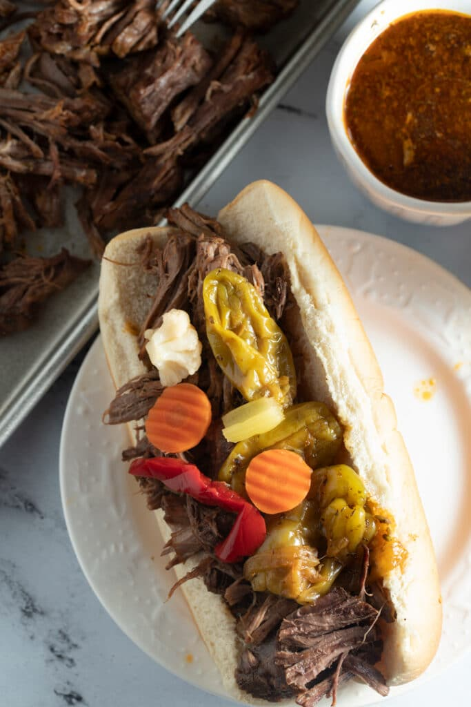 Italian beef in a roll with toppings