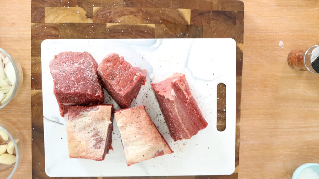 Beef on a white chopping board