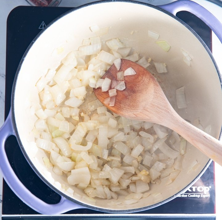 Softening the onions in a dutch oven