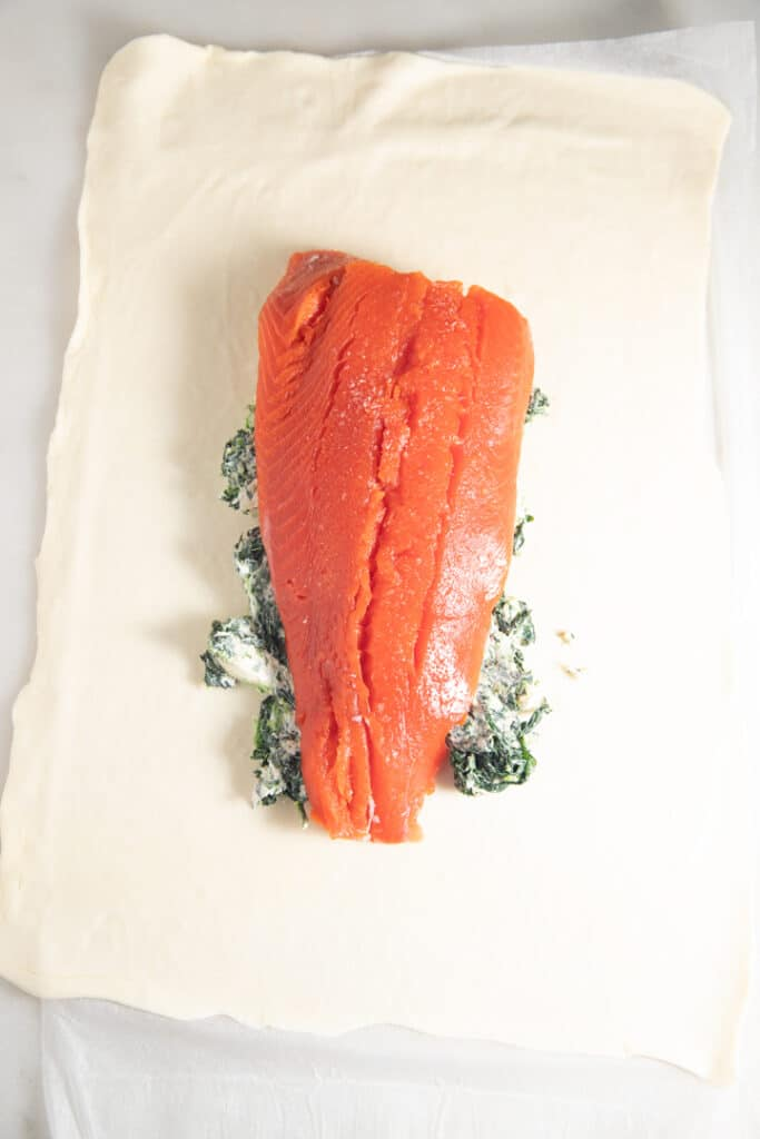 Salmon laid on top of the cream cheese mixture