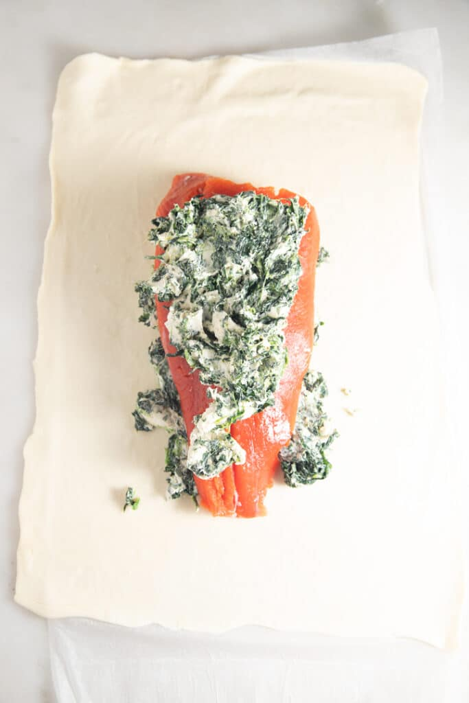 Cream cheese and pinach on top of the salmon fillet
